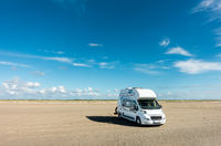 Camping Car RV standing on empty sand beach on sunny day. Romo Bilstrand, Lakolk Strand, Denmark.
