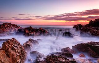 Rocky coastal seascape at dawn