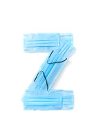 Letter Z made from protective medical masks on a white background.