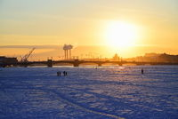 View of the Annunciation bridge, people on the ice of the Neva r