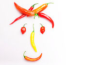 Happy red pepper face smiling, isolated on white background. Health, food, vegan, funny concept.
