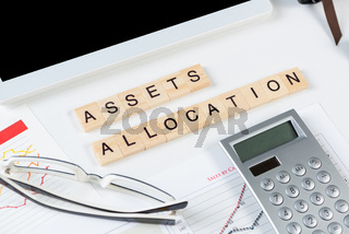 Asset allocation concept with letters on cubes