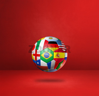 Football soccer ball with national flags on a red studio background