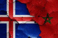 flags of Iceland and Morocco painted on cracked wall