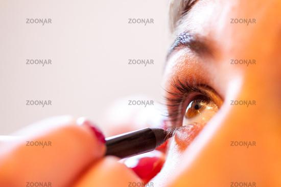 Applying Eyeshadow on a female