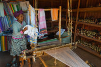 Ethiopian woman weaving scarves