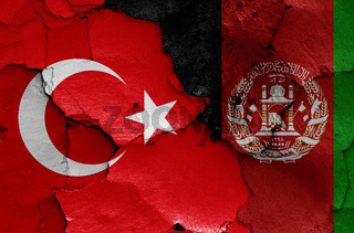 flags of Turkey and Afghanistan painted on cracked wall