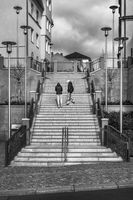 Up the stairs. . .