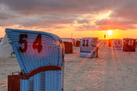 Sand Beach with Beach Chairs in Neuharlingersiel at Sunset, Lower Saxony, Germany