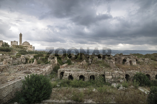 Ruins with view on the mosque with dramatic cloudscape in Tyre, Sour, Lebanon