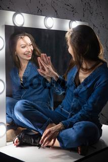 Happy woman dressed in denim overalls