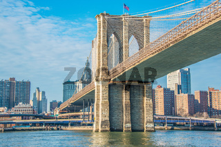 Brooklyn bridge in New York on bright summer day