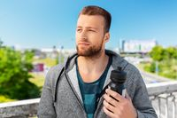 young man with sports bottle
