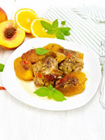 Turkey with peaches in plate