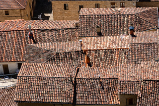 Background of old village houses with stone walls and red tile roofs