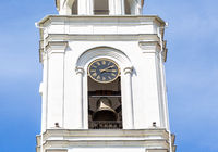 Fragment of bell tower of the Iversky monastery with bell and chime clock