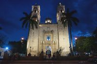 Front of the church San Servacio with palm trees in the night in the downtown of Valladolid, Yucatan