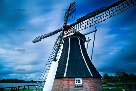 Dutch windmill over blurred sky