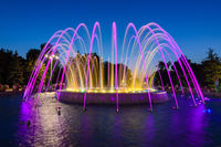 Anapa, Russia - July 17, 2020: A beautiful multi-colored fountain with high jets, located near the administration building in the city of Anapa resort