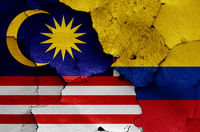 flags of Malaysia and Colombia painted on cracked wall