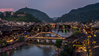 Night view of illuminated Xueqiao Snow Bridge in Feng huang