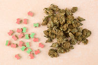 Ecstasy pills and marijuana buds.