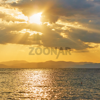 Sea and clouds with sunbeams