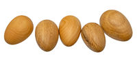 Hand-turned wooden eggs in a row isolated on white