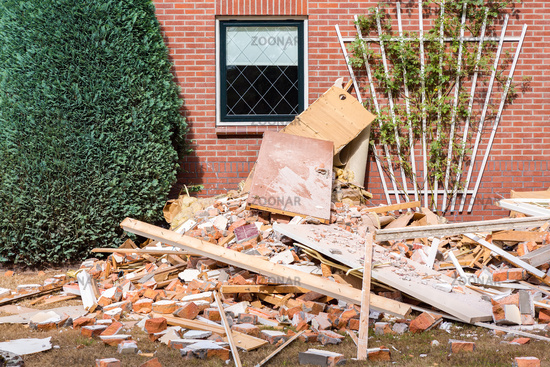 Renovation at dutch house with rubble in garden