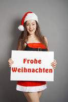 Frohe Weihnachten - female santa wishes merry christmas in German