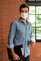Portrait of middle east businessman with face mask hold coffee cup