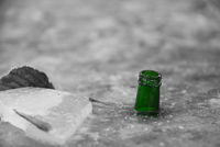 Green drinking bottle in black and white image - water level indicator