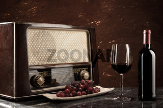 Enjoying wine and listening to the radio