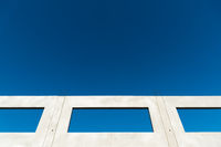 Window of a building shell with blue sky