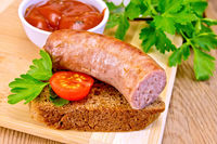 Sausages fried on bread with tomato