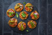Homemade small pizza with pesto