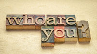 who are you question - word abstract  in wood type