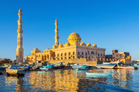 Mosque with fishing boats at sea in egypt
