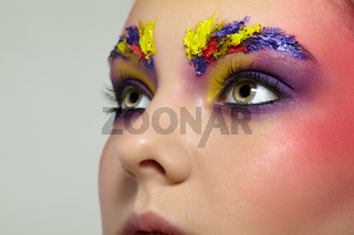 Close-up female portrait with unusual face art make-up.