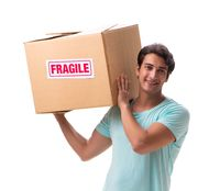 Young handsome man with fragile box ordered from Internet