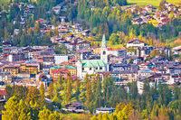 Town of Cortina d' Ampezzo in green landscape of Dolomites Alps