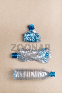 Squashed plastic bottles collected to recycling