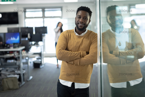 Portrait of businessman smiling at modern office