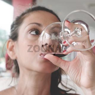 Pretty girl drinking red wine