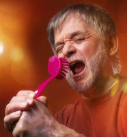 Crazy old man sing with kitchen brush