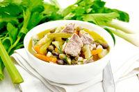 Soup Eintopf in bowl on board