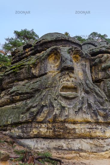 Sculptures Devil's heads in the village Zelizy - Czech republic