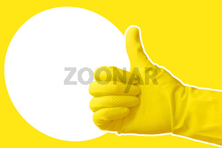 Hand in yellow protective rubber glove. Approved gloved hand thumbs up