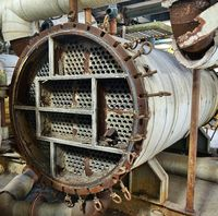 Large industrial boiler in a deserted factory building