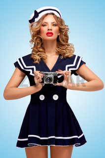 Sailor girl with camera.
